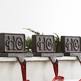 CTW Home Collection Set of Three Cast Iron 'Ho Ho Ho' Stocking Holders