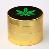 Gold-Plated Herb Grinder with Cannabis Leaf Logo on Top